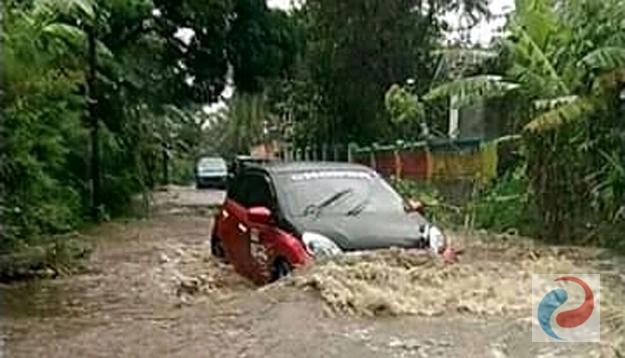 Permalink ke Banjir Musiman Hantam Jalan Aspal di  Empat Desa di Kecamatan Pujer Bondowoso